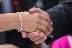 Man and woman handshake Stock Photos