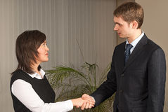 Business man and woman handshake in office Stock Images