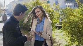 Business man and woman having meeting and conversation outdoor. Shot in 4k