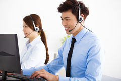 business man and woman with headset working in office Royalty Free Stock Photography