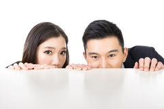 Business man and woman hide royalty free stock photography