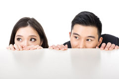 Business man and woman hide Stock Images
