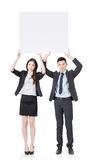 Business man and woman holding blank white board Royalty Free Stock Image