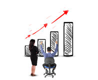 Business man and woman looking success with profit graph Royalty Free Stock Photos