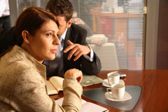 Business man and woman  in the office Stock Photography