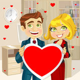 Business man and woman in office hold a valentine Royalty Free Stock Images