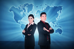 Business man and woman over world map background Stock Image