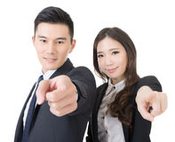 Business man and woman point at you Stock Image