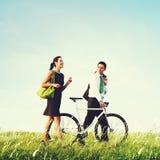 Business Man Woman Pushing Bike Concept Stock Photos