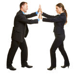 Business man and woman pushing hands stock photo