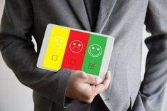 Business man and woman select happy on satisfaction evaluation? Stock Images