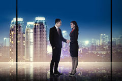 Business man and woman shaking hand Royalty Free Stock Images