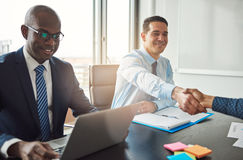 Business man and woman shaking hands stock images