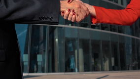 Business man and woman shaking hands stock footage