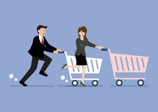 Business man and woman are shopping with a cart Stock Photo