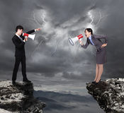 Business Man and woman shouting to each other Royalty Free Stock Image