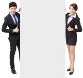 Business man and woman showing the empty board Stock Photography