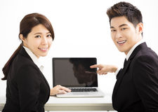 business man and woman showing laptop Royalty Free Stock Photography