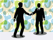 business man and woman silhouette in handshake pose Stock Photography