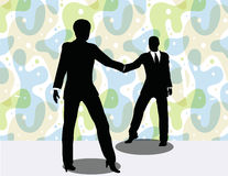 business man and woman silhouette in handshake pose Stock Photos