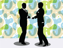 business man and woman silhouette in handshake pose Stock Photo