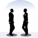 Business man and woman silhouette in standing pose Stock Photo