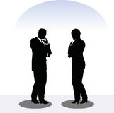 Business man and woman silhouette in standing pose Stock Photography