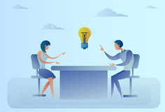 Business Man And Woman Sitting At Desk Discuss New Creative Idea Concept Light Bulb Stock Images