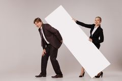 Business man and woman standing over blank banner Royalty Free Stock Image