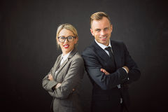 Business man and woman standing with their hands crossed Royalty Free Stock Photos