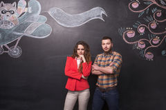 Business man and woman in studio royalty free stock photos