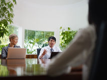 Business man and woman talking in meeting room stock images