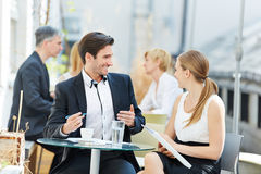Business man and woman talking outdoors Stock Images