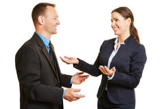 Business man and woman talking to each other Royalty Free Stock Images