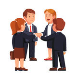Business man and woman team putting hands together. Business people man and woman putting hands together while standing. Executive management teamwork, team Stock Photo