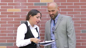 Business Man and Woman Teamwork Talking Concept. Video