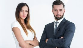A business man and woman with their hands crossed. Smiling co workers standing next to each other on white background Royalty Free Stock Images