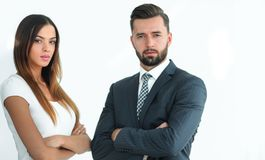 A business man and woman with their hands crossed. Smiling co workers standing next to each other on white background Royalty Free Stock Image