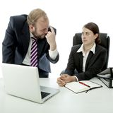 Business man woman think employee is stupid. Beard business men brunette women sitting at desk think employee stupid in front of white background royalty free stock images