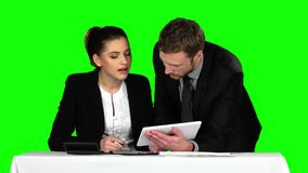 Business man and woman using laptop in office lobby. Green screen. Business man and woman using laptop in office lobby, business work, two successful businessman stock video