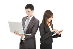 Business man and woman using laptop and touch pad Stock Images