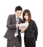 Business man and woman using the tablet pc. Businessman and businesswoman using the tablet pc Stock Photo