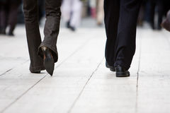 Business man and woman walking Stock Photography