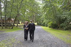 Business Man and Woman Walking In Camp Royalty Free Stock Photos