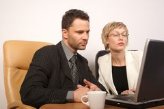 Business man & woman working together 2. Man and woman busy with office work royalty free stock image