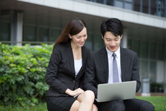 Business man and woman working together Royalty Free Stock Photo