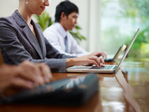 Business man and women typing on pc during meeting Royalty Free Stock Image