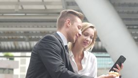 Business man and business women using smart phone, Business concept. stock video footage