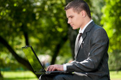 Business man work on notebook Stock Photography