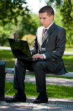 Business man work on notebook at park. Student Stock Photos